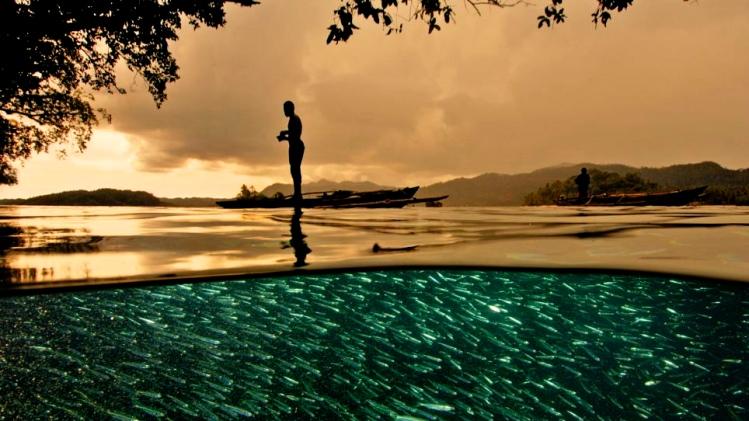 Papuan fisherman Raja Ampat Indonesia